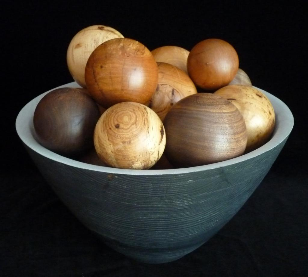 "2018; pine and milk paint (bowl), cherry, walnut, pecan, and pear spheres; 14"" x 14"" x ""11""H"